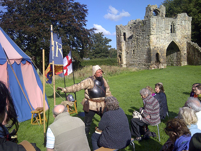 Re-enactor at Etal Castle telling the Society about the battle of Flodden