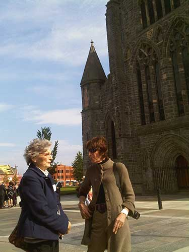 Sandy Winnifrith and Lulla in front of Abbey